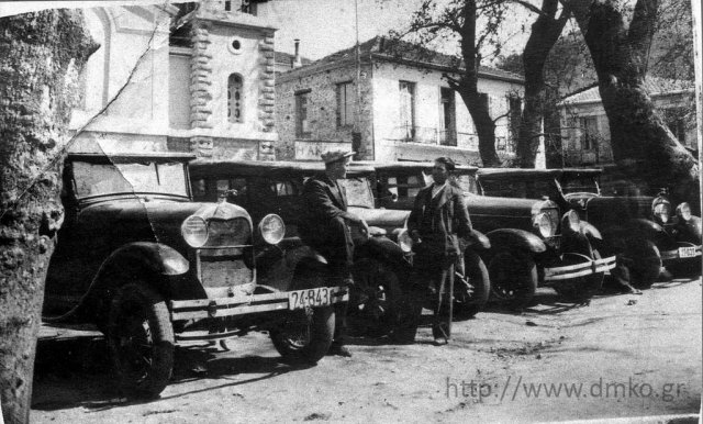 The taxi rank at the square of Kalavrita in front of the Cathedral - two of the first owners, George Liakopoulos (Vlahavas) and Emmanuel Spyropoulos.